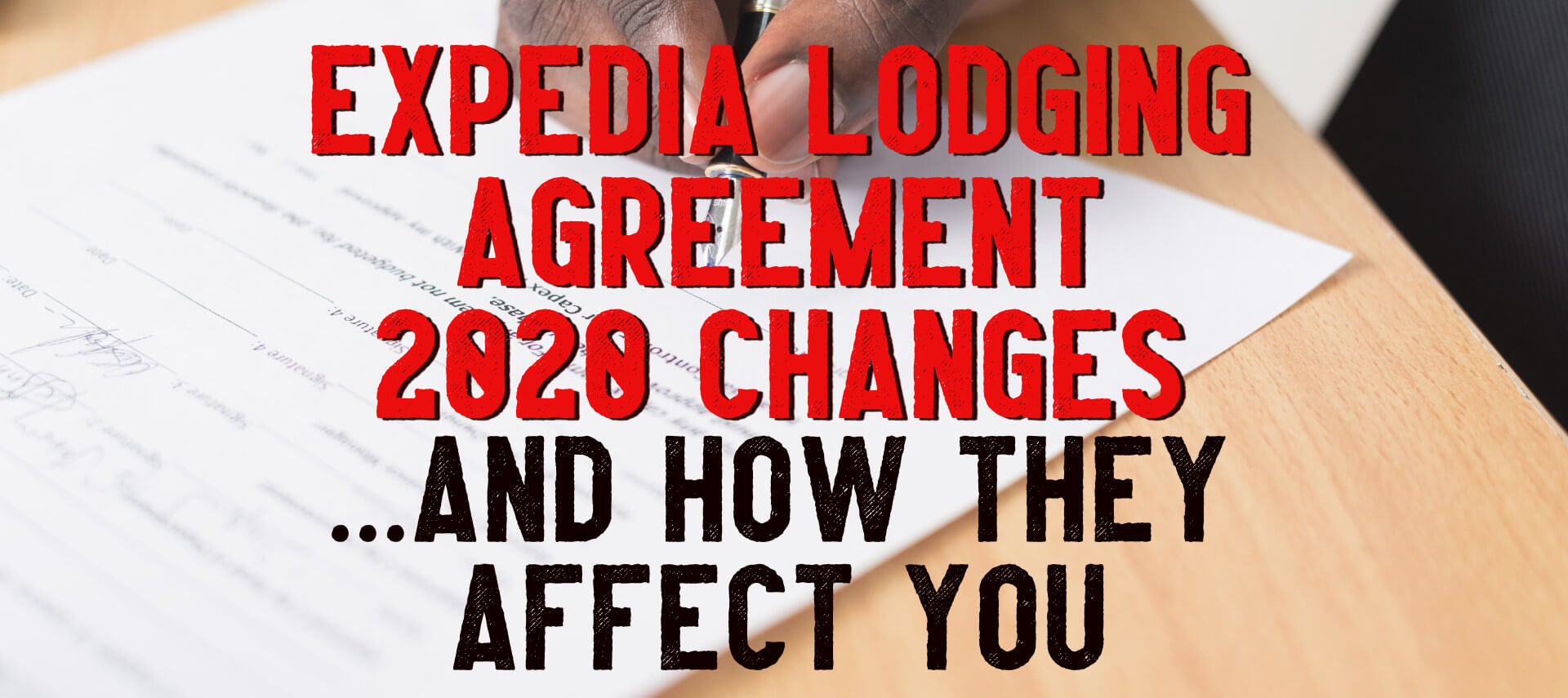 Man's hand with pen signing contract - Expedia Lodging Agreement Changes and How They Affect You