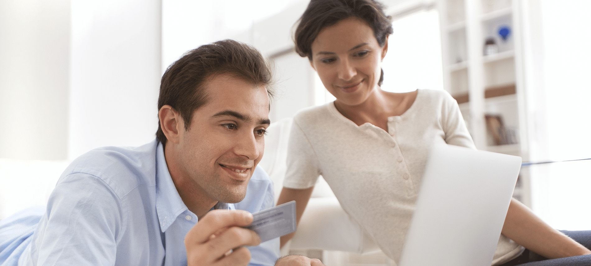 Man and woman ordering online with a credit card